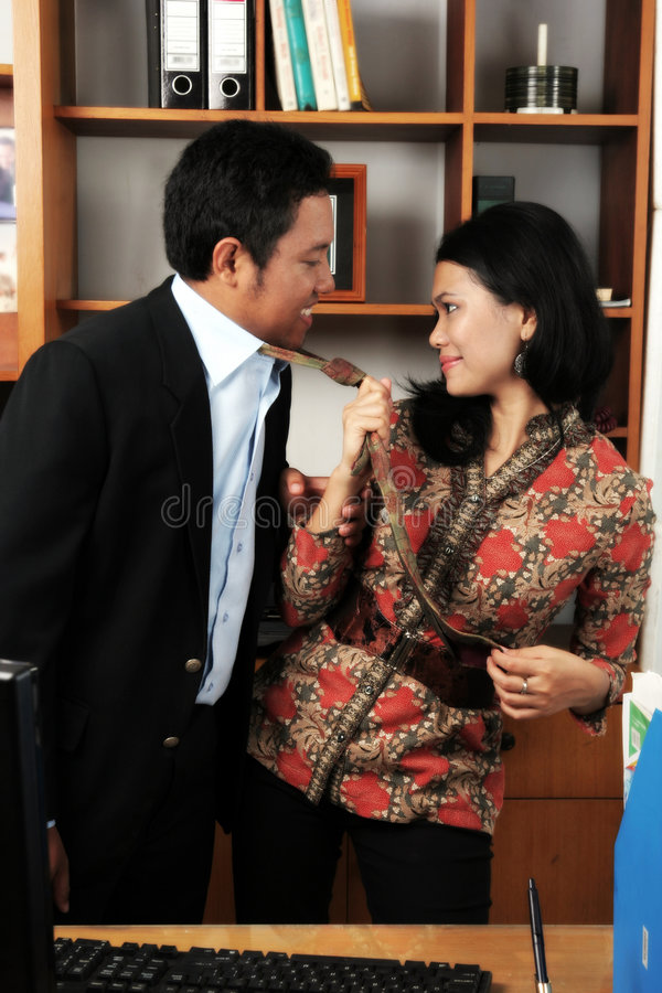Couple in office stock photo