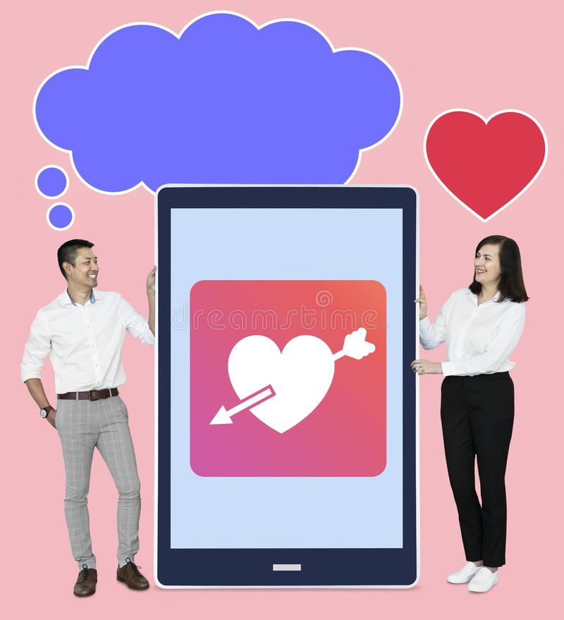 Couple with an online dating application royalty free stock image
