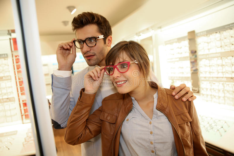 Couple at the optical store royalty free stock images
