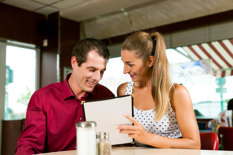 Download Couple Order In A Bar Or Restaurant Stock Image - Image of girlfriend, choose: 22211121