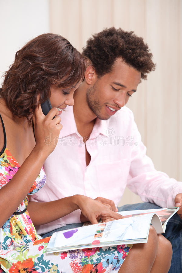 Couple ordering by phone stock photos