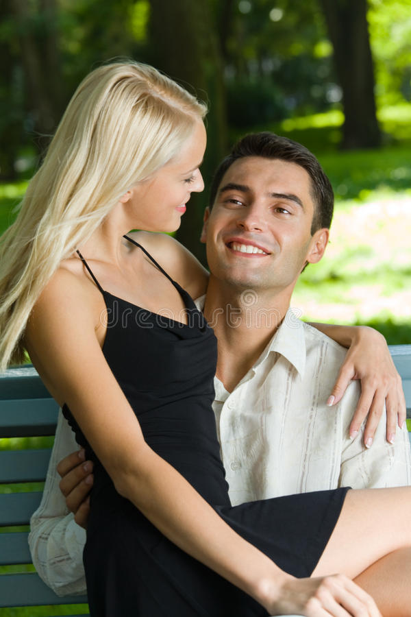 Couple outdoors. Young happy couple together, outdoors stock photo