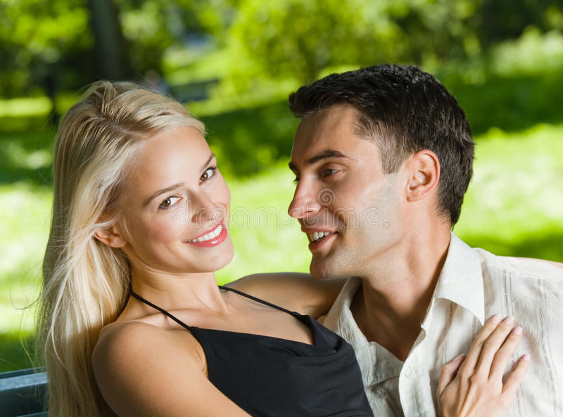 Couple outdoors. Young happy couple together, outdoors royalty free stock photo