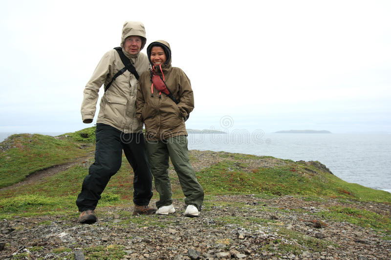 Couple Outdoors in Rain and Wind Gear royalty free stock images