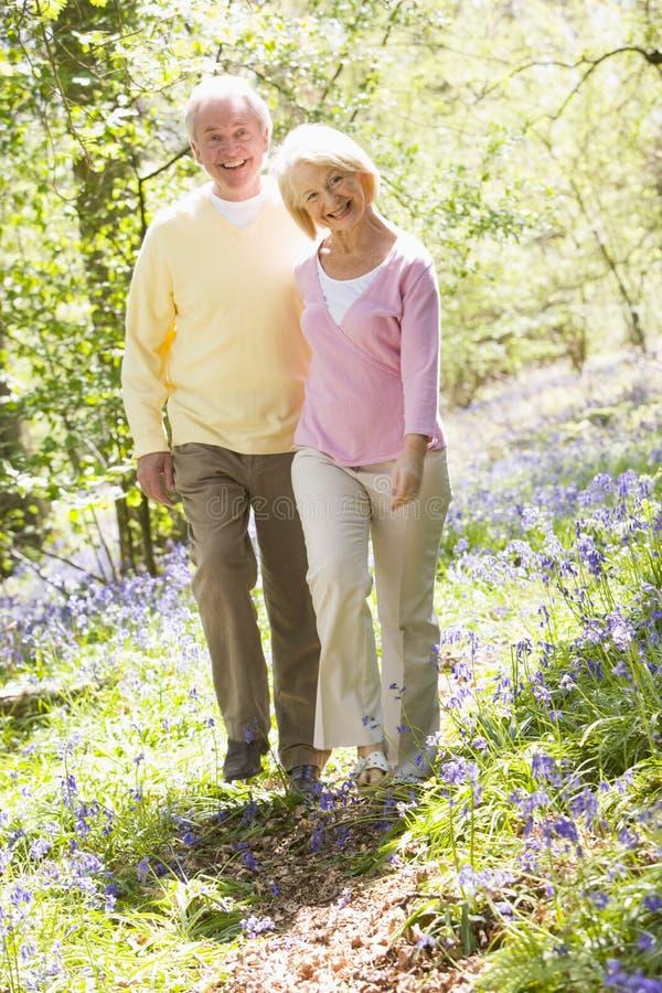 couple outdoors smiling walking στοκ εικόνες
