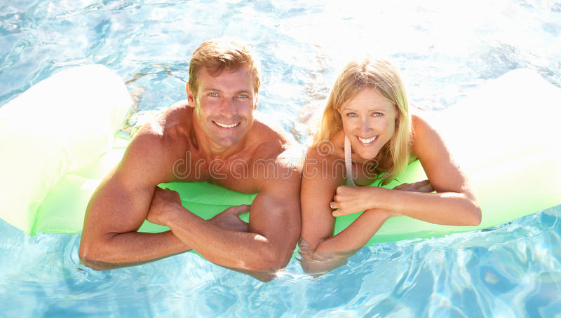 Download Couple Outside Relaxing In Swimming Pool Stock Photo - Image: 14927858