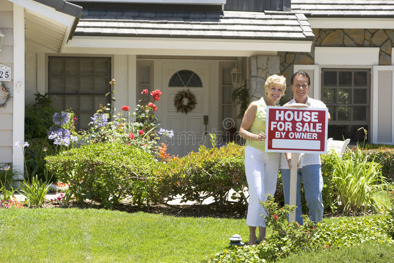 Couple Outside There House For Sale stock photos