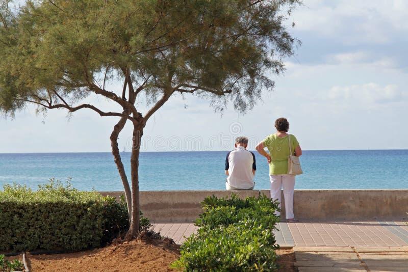 Couple overlooking ocean stock photo