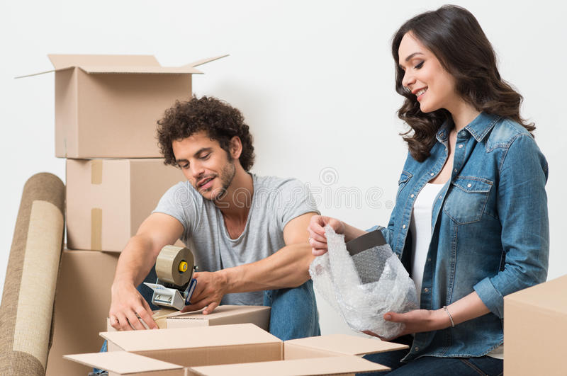 Couple Packing Cardboard Box royalty free stock photography
