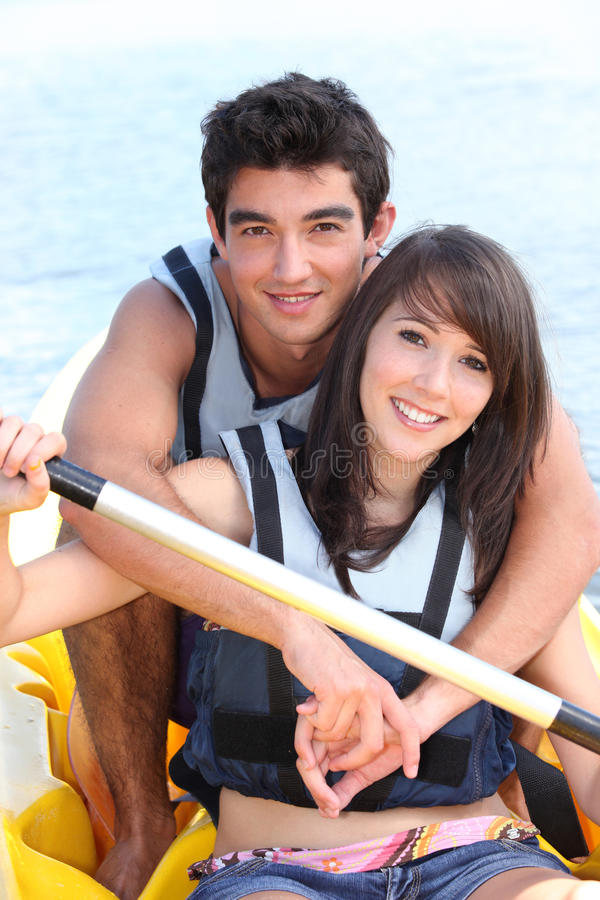 Couple in a paddle boat stock image