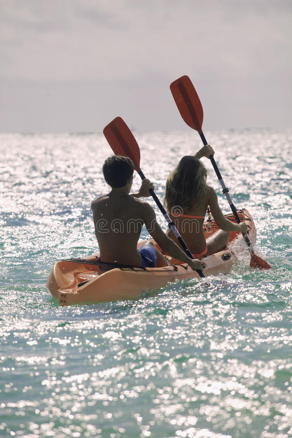 Download Couple Paddling Their Kayak Stock Photo - Image of couple, tropics: 26151372