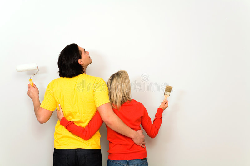 Couple with paint brushes stock photo