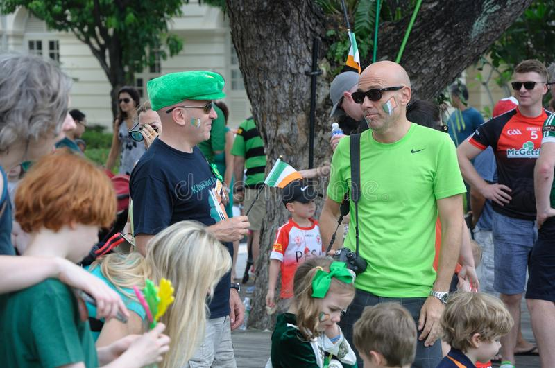 Paraders mingling at Empress Lawn in Singapore during the 2018 Saint Patrick`s Day stock photos