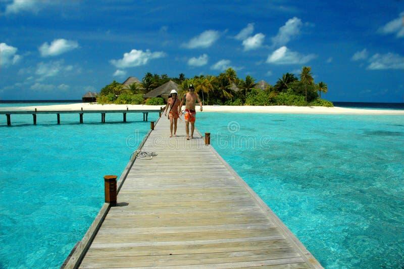 A couple in paradise. A couple going a bar along