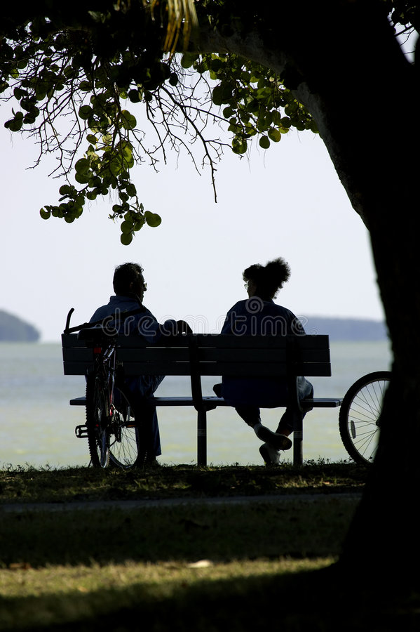 Couple on park bench stock photography