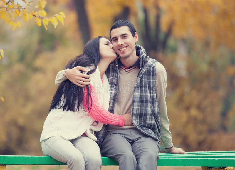 Couple in the park. Teen couple at the park in autumn time royalty free stock image