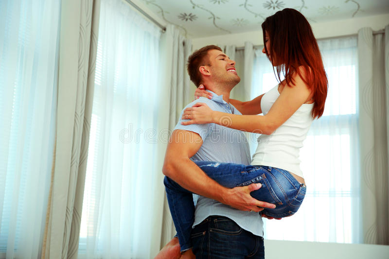 Couple in passionate embrace. Beautiful couple in passionate embrace at home stock photography