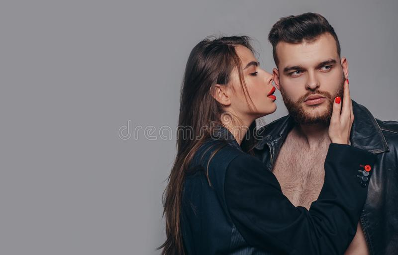 Couple passionate people in love. Passion fashion. Man brutal well groomed macho and attractive feminine girl long hair royalty free stock image