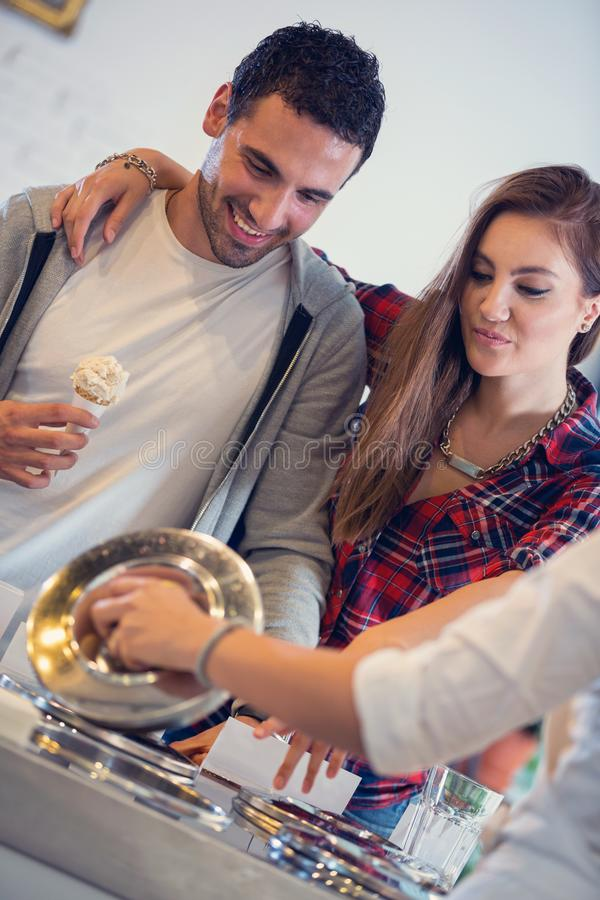 Couple in pastry shop stock photos