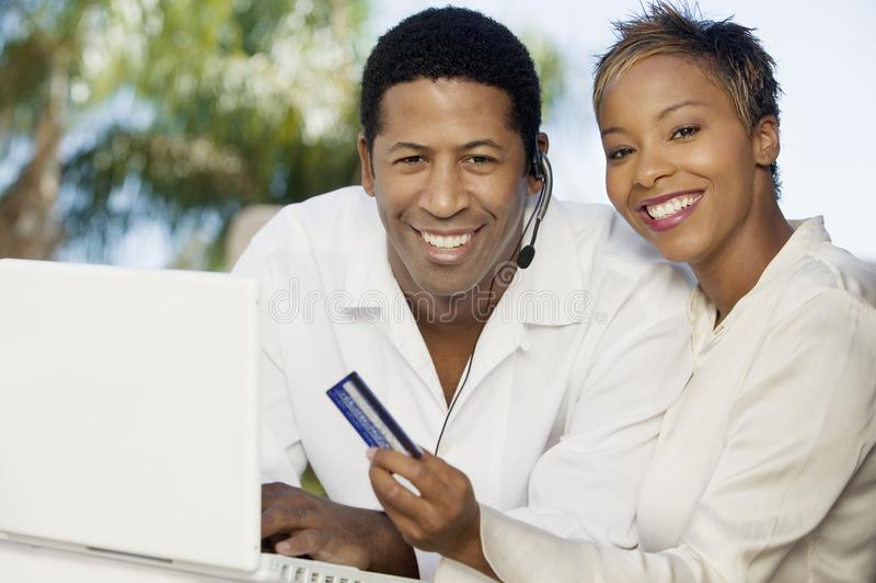 Download Couple On Patio Making Online Credit Card Purchase Stock Photo - Image: 13584332