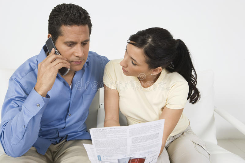 Couple Paying Bill On Phone stock photos
