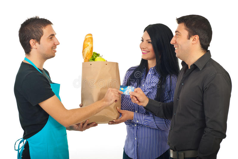 Couple paying with credit card at grocery stock photography