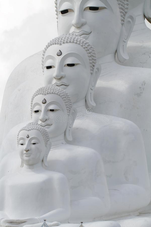 Couple peaceful white buddha statues sitting well alignment and decorating wonderful attractive mirror stock images
