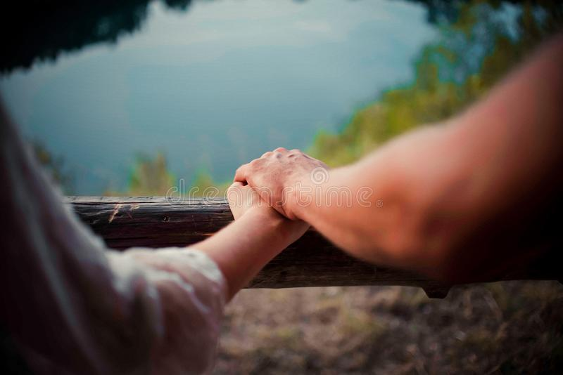 A couple of people holding hands royalty free stock photos