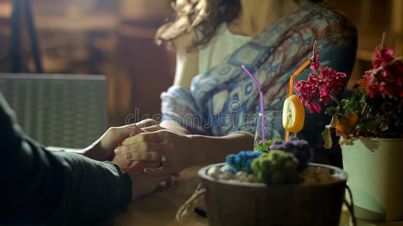 Couple of people in love holding hands gently, romantic date, mutual love story. Stock footage stock image