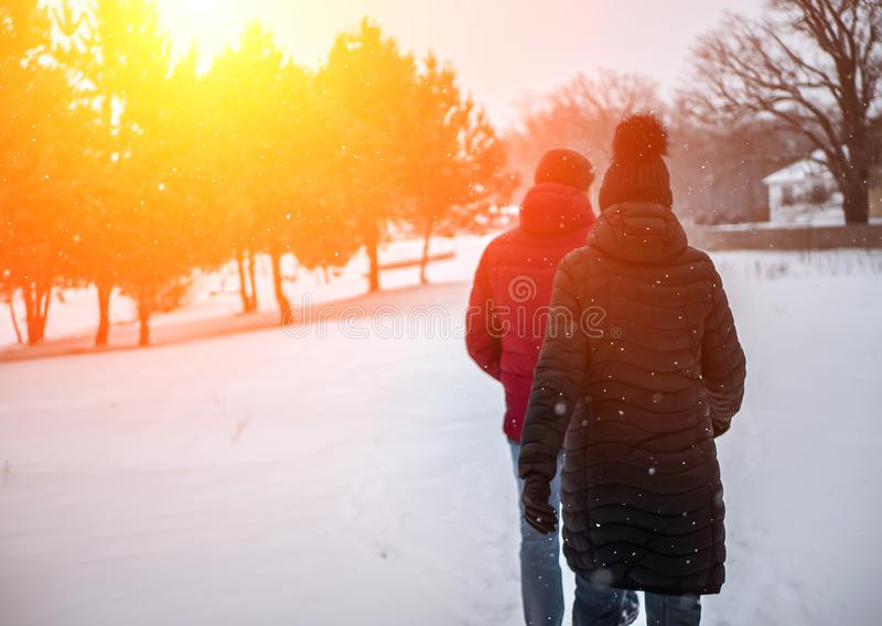 A couple of people walk in the winter Park stock images
