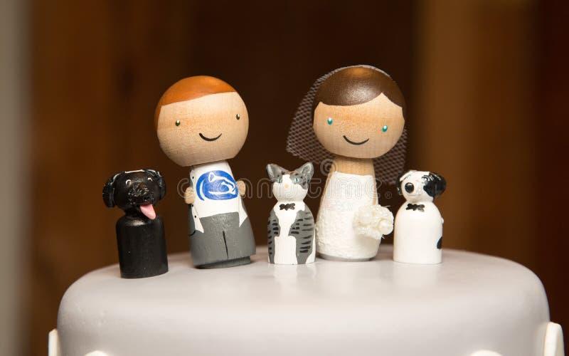 Couple with pets on wedding cake royalty free stock image