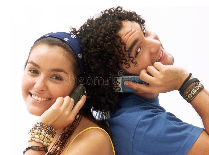 Couple phone. Young couple using a mobile phone. Young couple talking themselves by mobile phone
