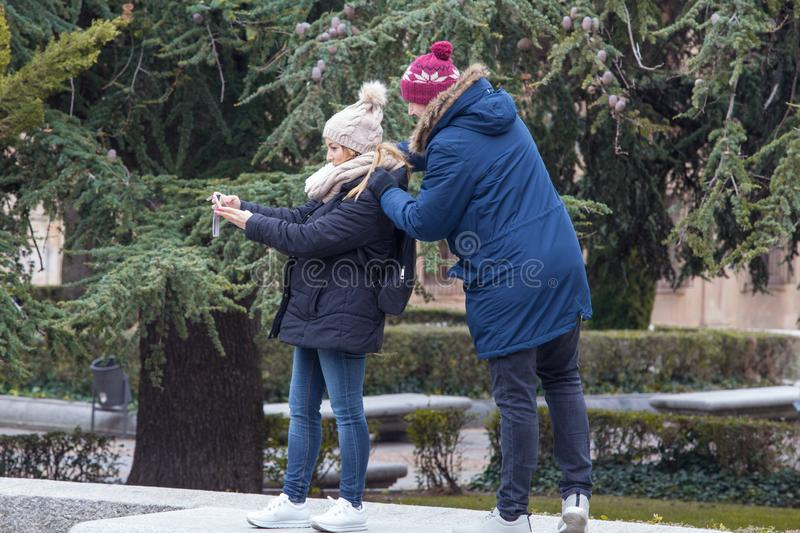 Couple photographing in old town, Salamanca royalty free stock images