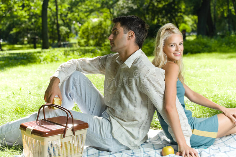 Couple at picnic. Young couple at picnic, outdoors royalty free stock photo