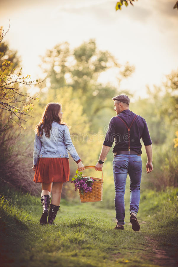 Couple with picnic basket. stock images