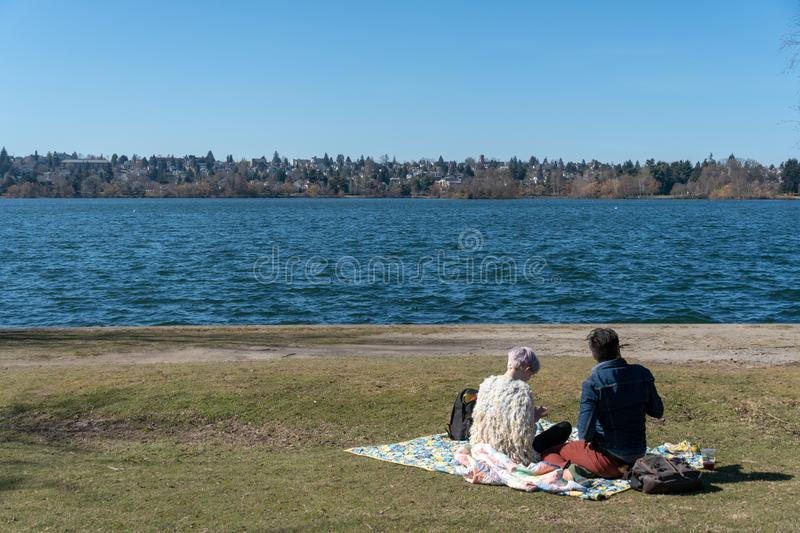 Couple picnic in Greenlake royalty free stock photo