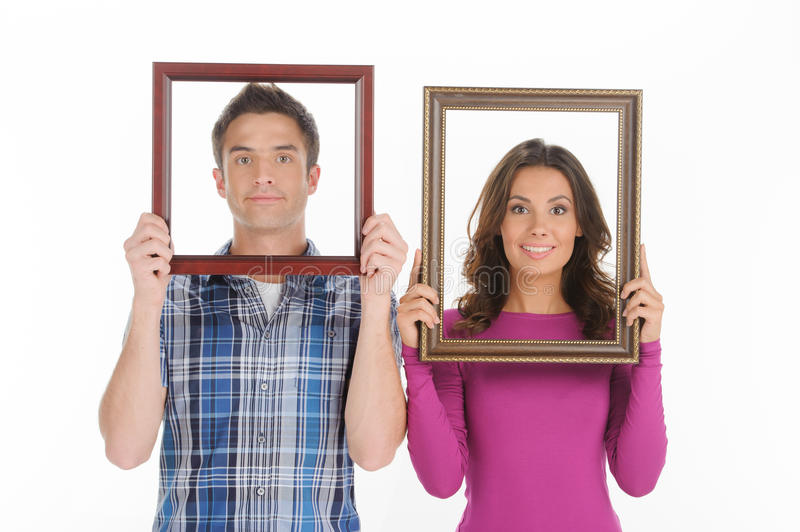 Couple with picture frames. stock photos