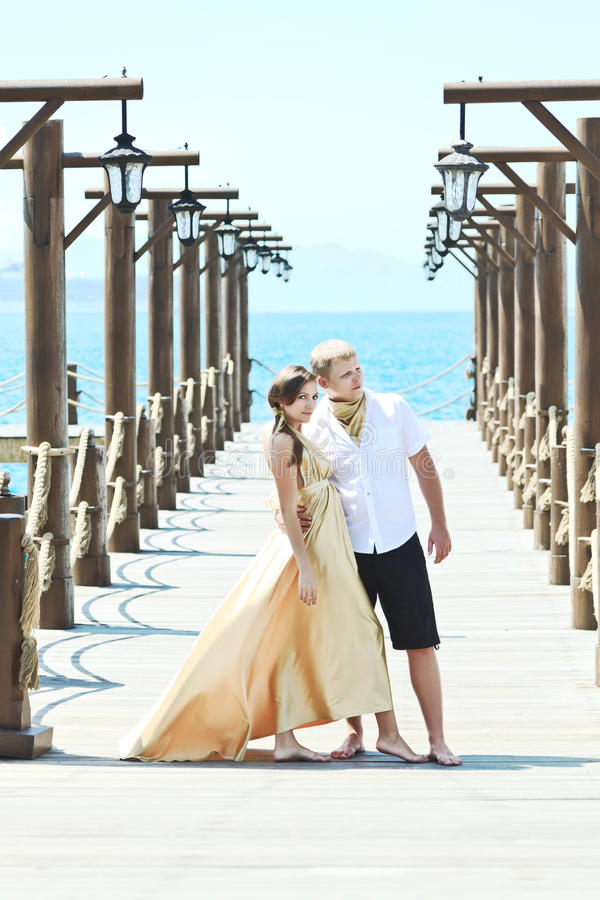 Download Couple on pier stock photo. Image of newlyweds, beautiful - 19222218