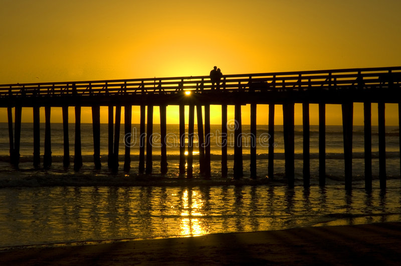 Download A Couple on a Pier stock photo. Image of content, coast - 2251926