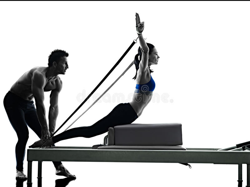 Couple pilates reformer exercises fitness isolated royalty free stock photos