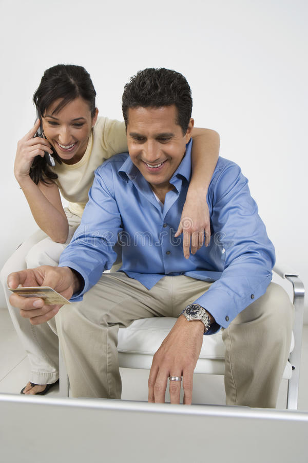 Download Couple Placing Order On Cell Phone Stock Photo - Image: 29661110
