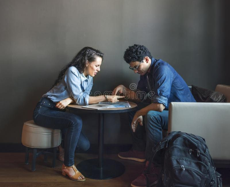 Couple planning their trip stock images