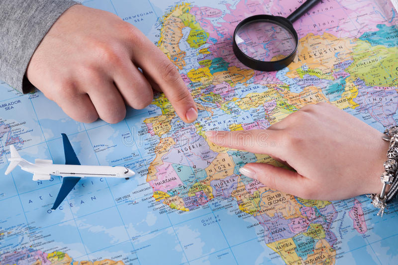 Couple planning trip to Tunisia, point on map royalty free stock images