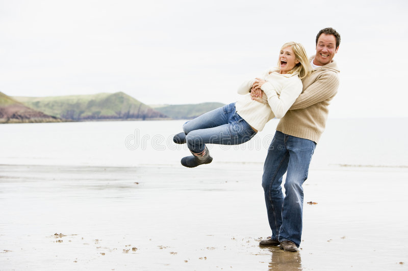 Download Couple playing on beach stock image. Image of affectionate - 5937687