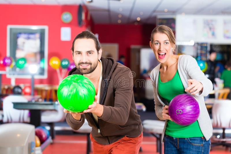 Couple playing Bowling. At bowling center stock images