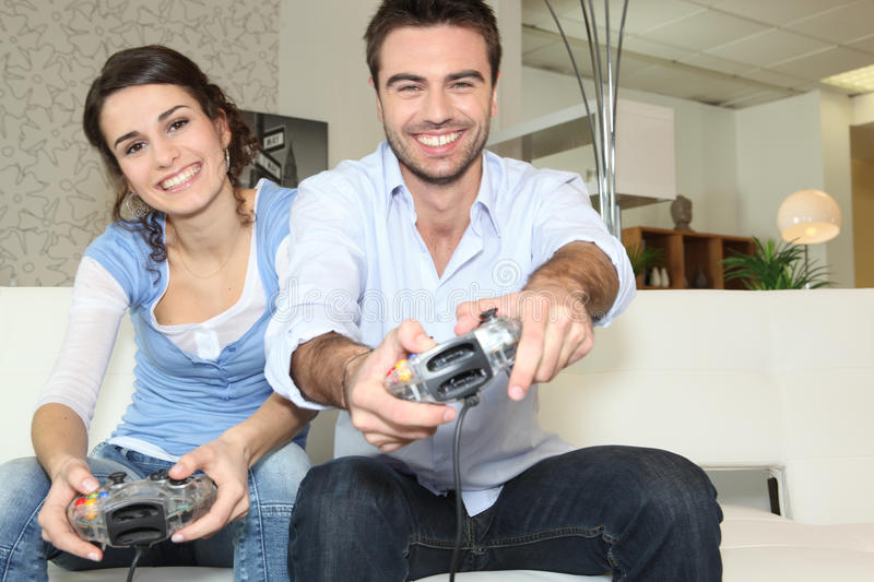 Couple playing computer games. At home stock photo