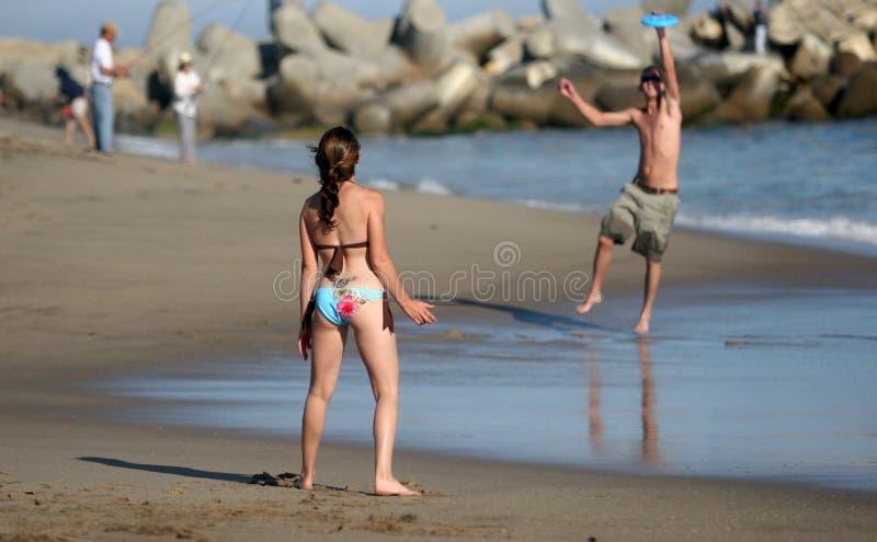 Couple playing frisbee stock photo