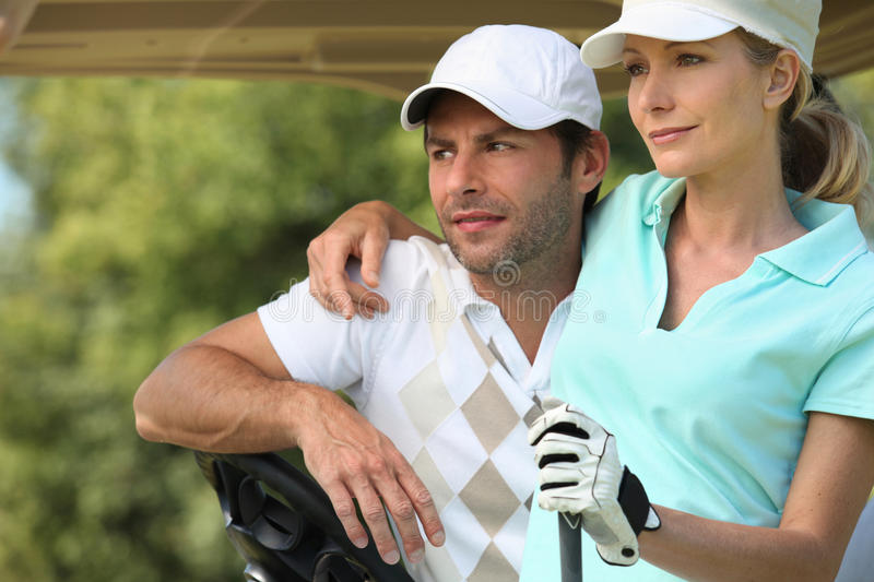Couple playing golf stock images