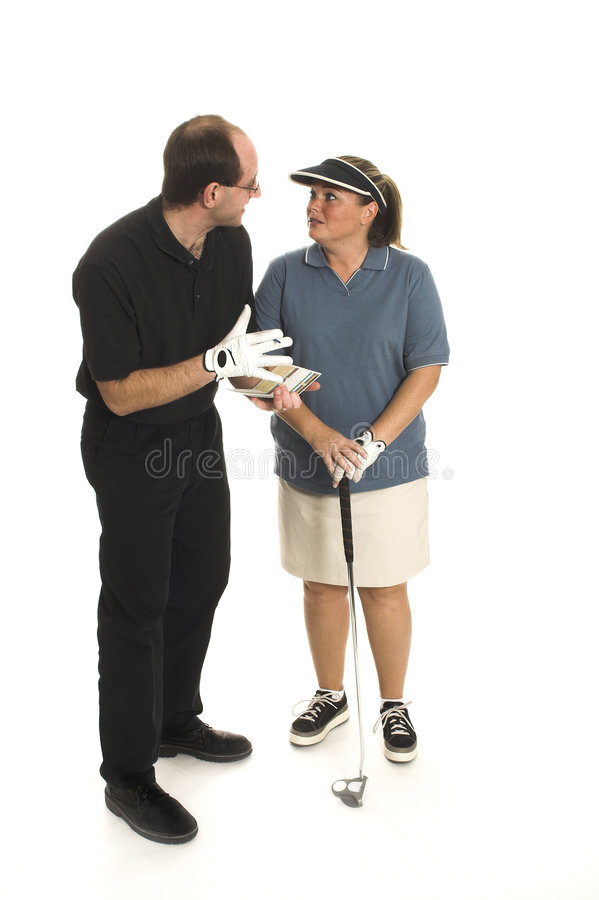 Couple playing golf stock photography