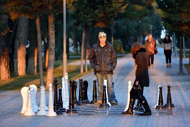 Couple playing street chess in Sumgait, Azerbaijan stock photo